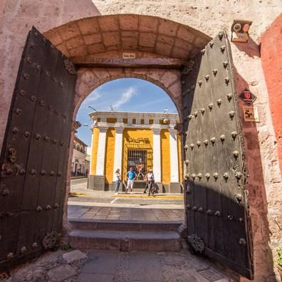 Arequipa, Peru. This ancient gate is a nice frame to the colorful streets of Arequipa.