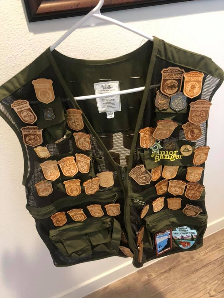 junior ranger badges on vest