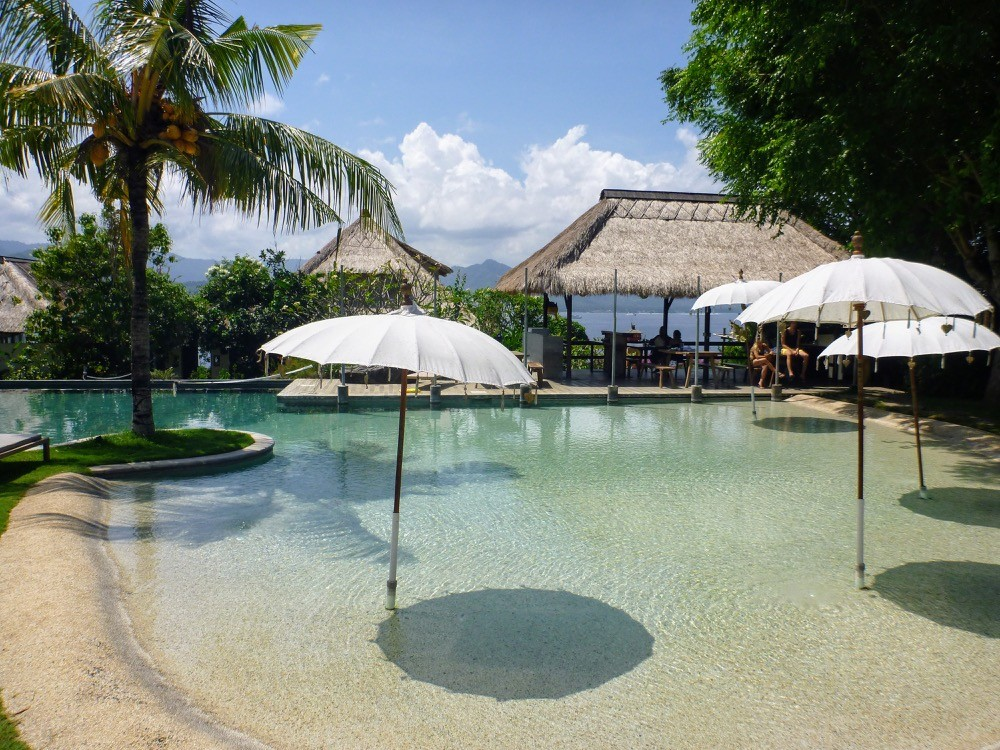 One of the pools with umbrellas at the Blue Lagoon resort in Bali Indonesia