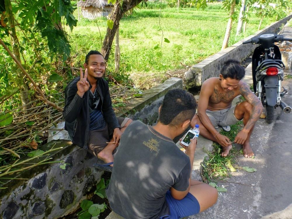Indonesian men taking a break in the shade