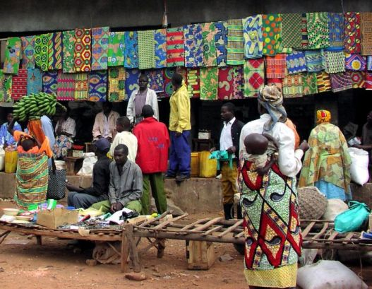 Market scene in Rwanda - selling fabric - men at work © Neil Palmer
