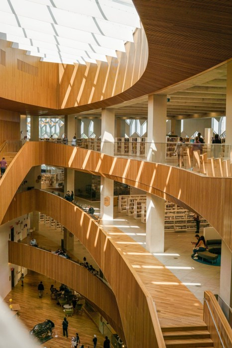 wooden railings and glass ceiling at a public library - free things to do in Calgary