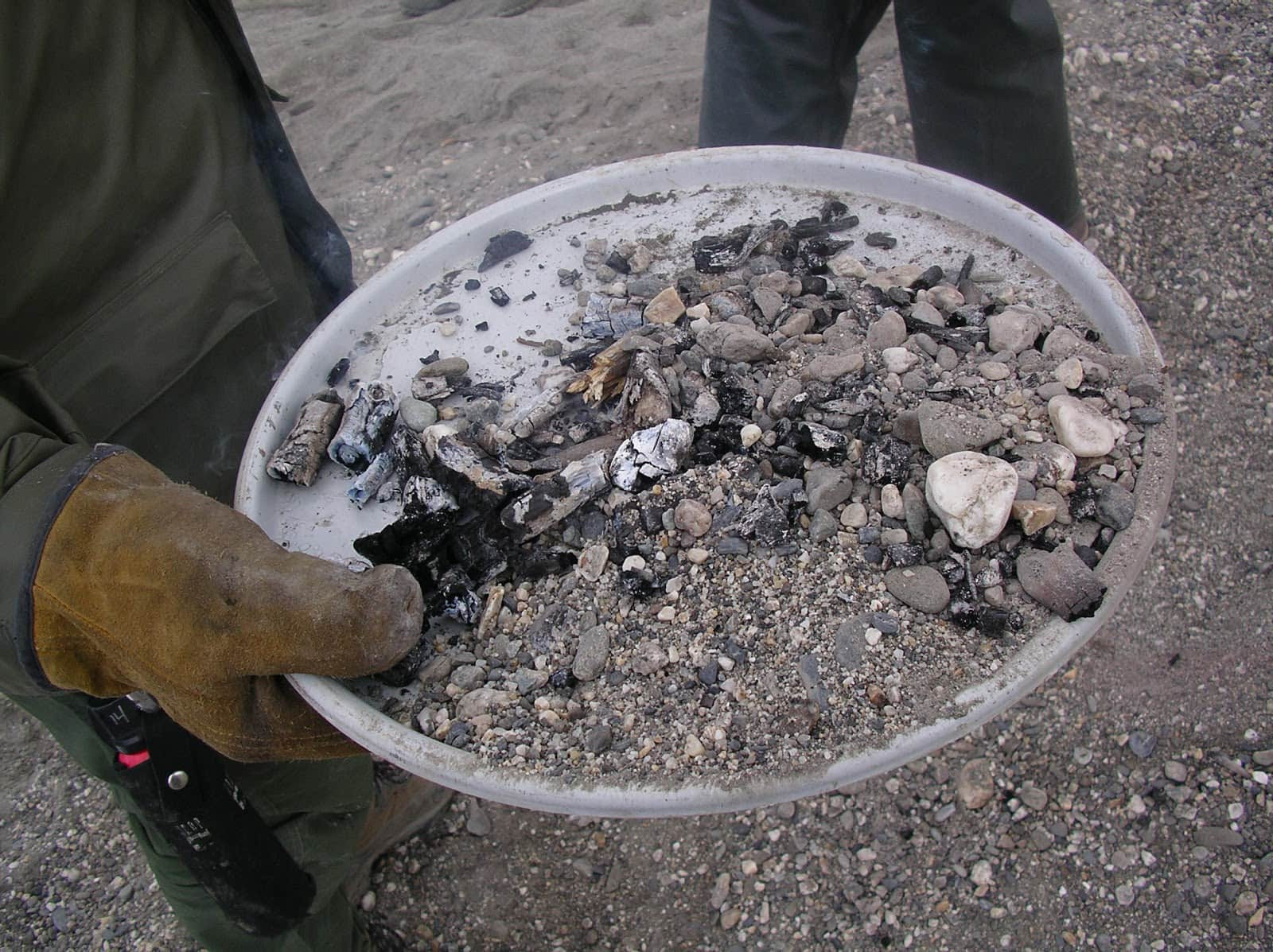 Caption: A fire pan significantly reduces the amount of impact that a campfire will have on the topsoil and the local ecosystem. Image provided by U.S. Government National Park Service