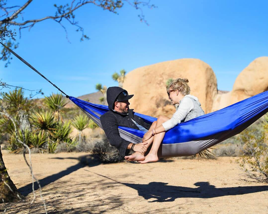 couple laughing in a serac camping hammock
