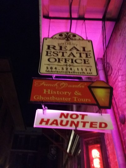 shows a sign for French Quarter History and Ghostbuster tours