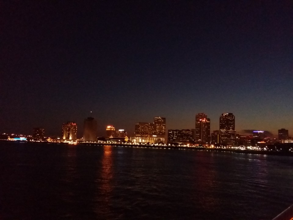 New Orleans skyline at night as seen aboard a boat of the Mississippi River