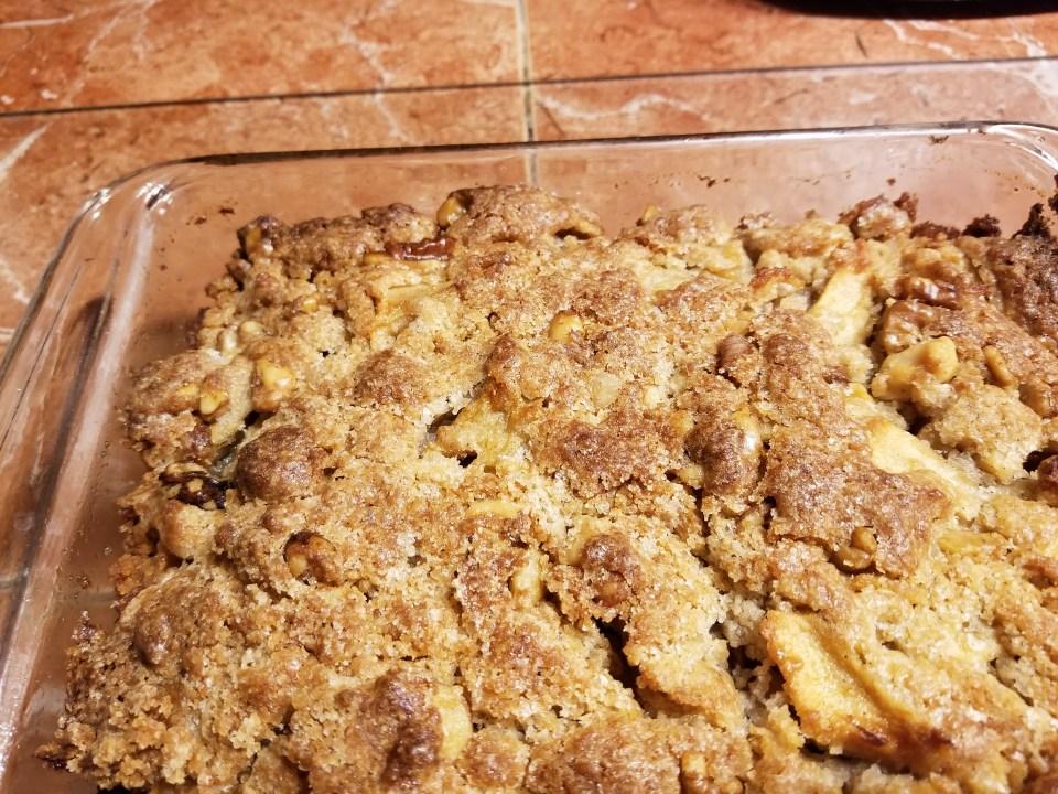 Octoberfest dessert, apple cake with walnuts in a baking pan