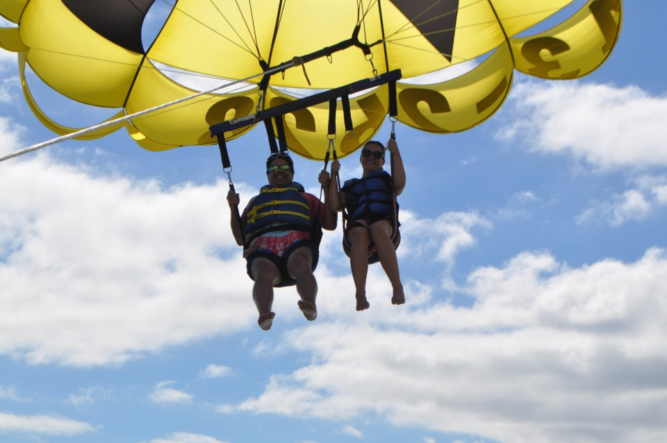 Photo of two people parasailing