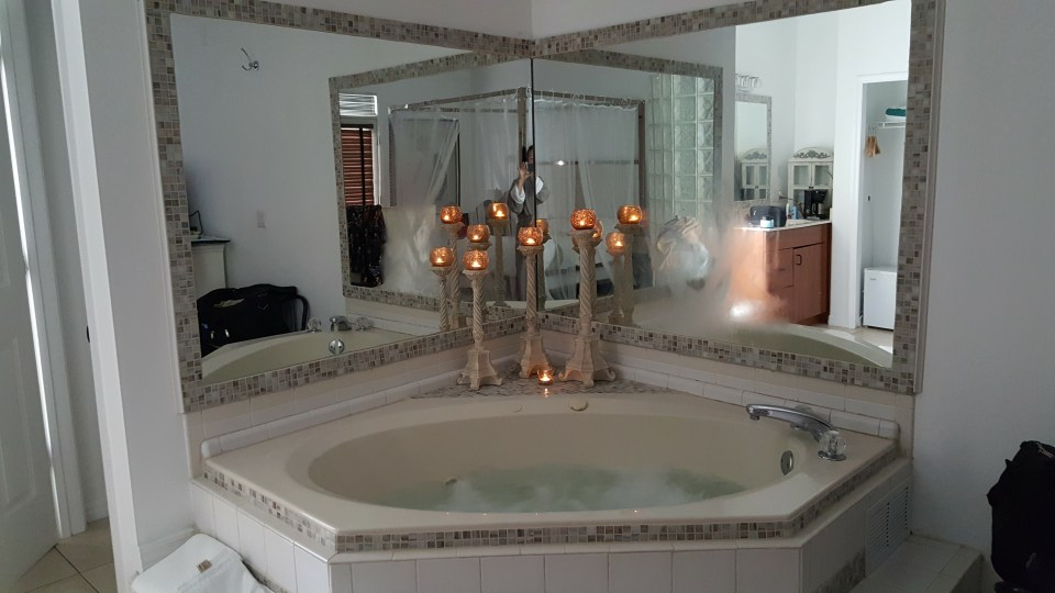 Romantic Jacuzzi with lit candles in a room for romantic getaways in Florida