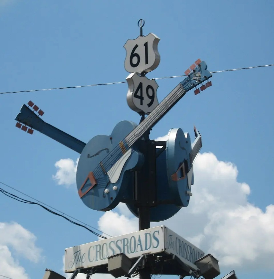 Shows the crossroads sign in Clarksdale, Mississippi