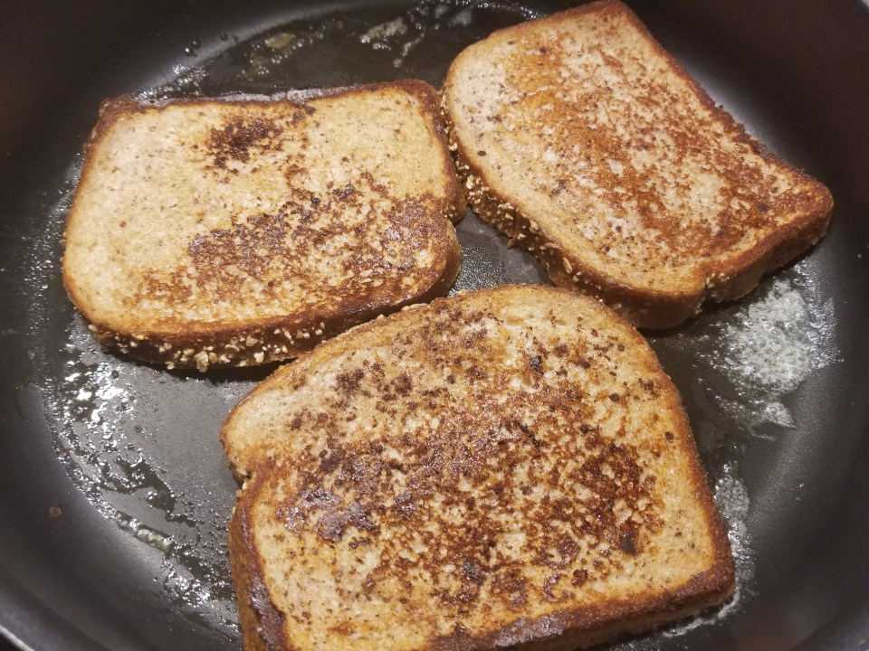 3 cooked pieces of French Toast in a pan