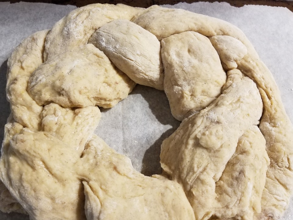 braided dough in a ring representing the Holy Trinity part of Easter dinner traditions in Greece