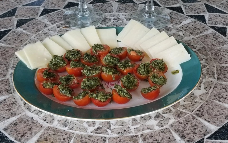 on Nonna's menu tonight, cherry tomatoes halved and stuffed with basil walnut pesto on a serving platter