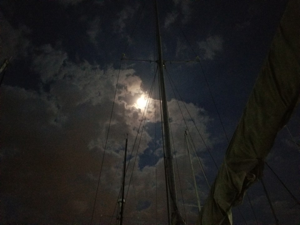 view of clouds passing in front of the moon