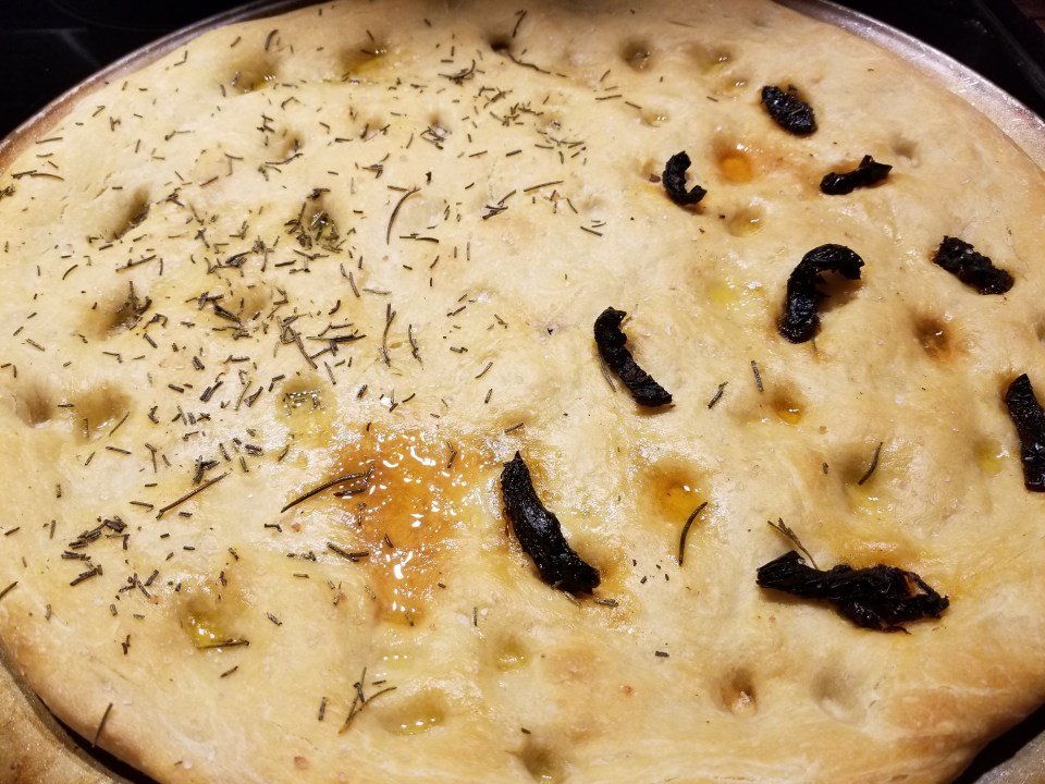 Nonna's menu shows focaccia bread with sundried tomatoes and rosemary.