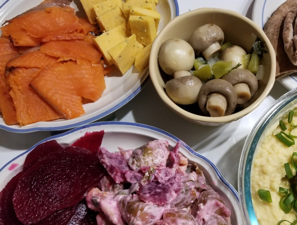 Scandinavian appetizer of gravlox, pickled beets, potato salad, pickled mushrooms, and Danish cheese