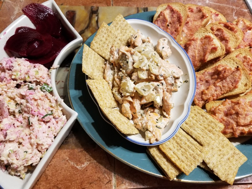 shows appetizer ideas from Yugoslavia: pickled beets, coleslaw, salmon in creamed herb sauce, and hot ham canapes