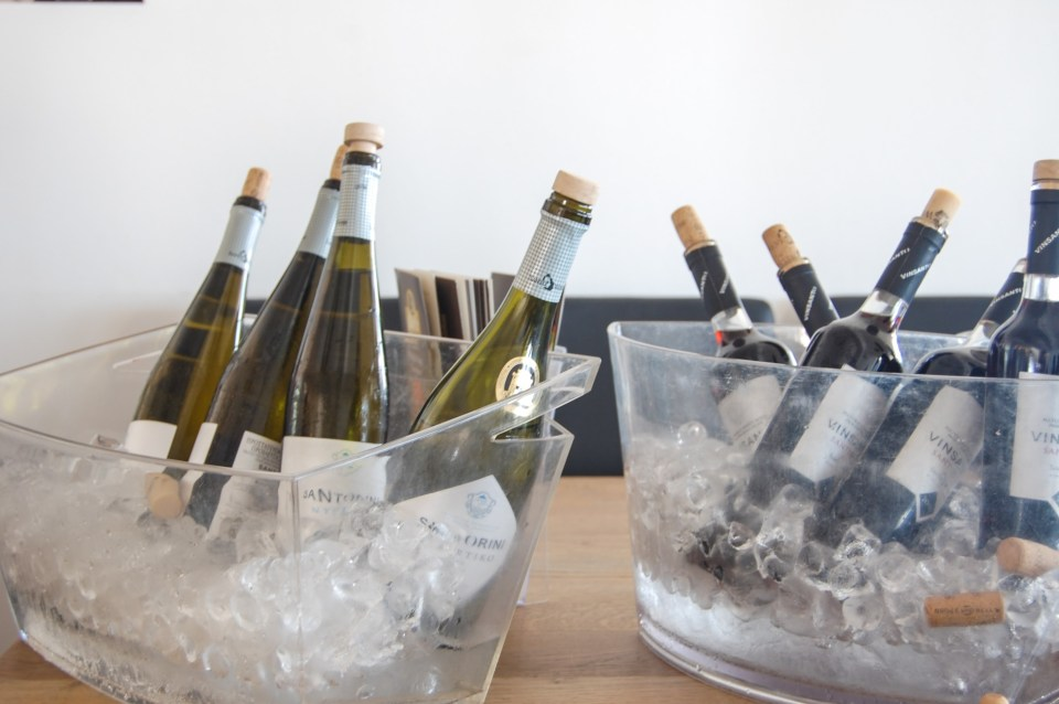 shows several bottles of wine on ice in preparation for wine tastings