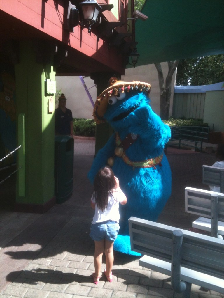 a child talking with Cookie Monster