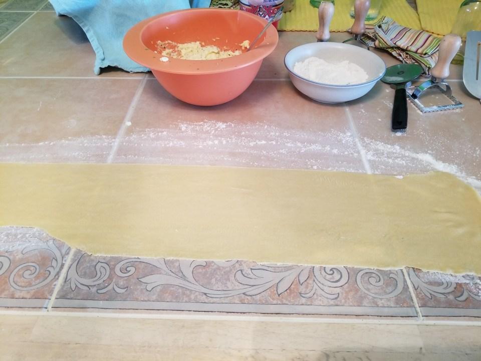 pasta sheet ready for filling half moons