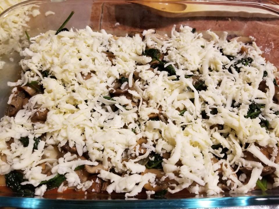 layered sauce, pasta sheets, veggie filling, and mozzarella cheese as part of preparing homemade pasta recipes