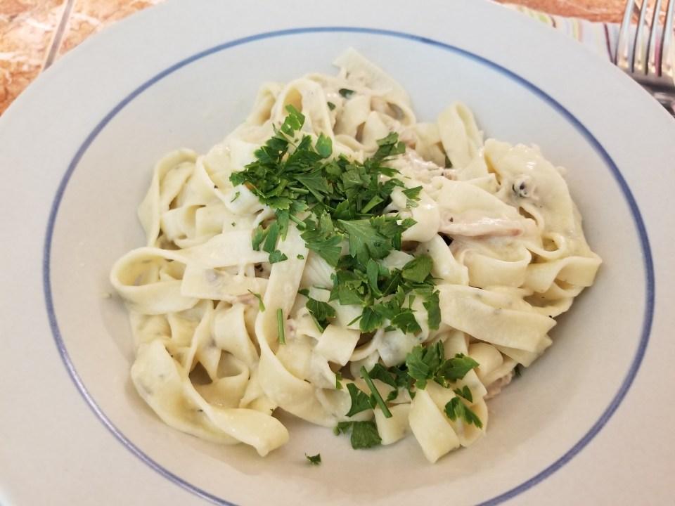 bowl of homemade alfredo sauce for pasta over Fettuccine