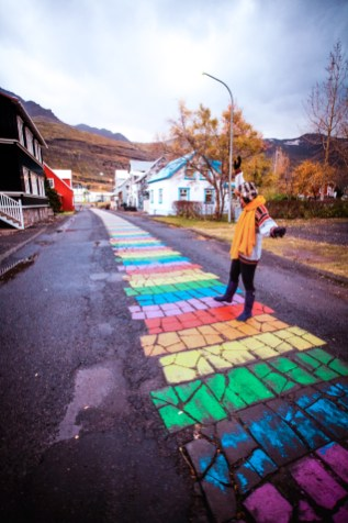 Woman walking in the colourful Iceland village