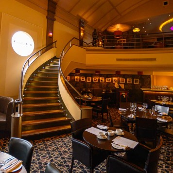 Curved staircase at the Art Deco Daffodil restaurant