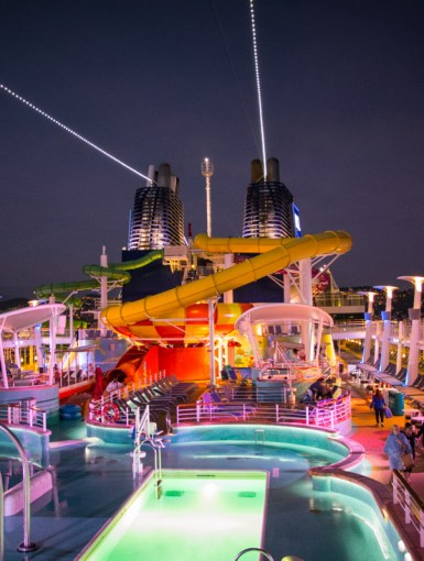 Ad • Norwegian Epic Pool Deck, At Night, Sailaway