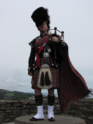 Bagpiper upon a Scotland Castle