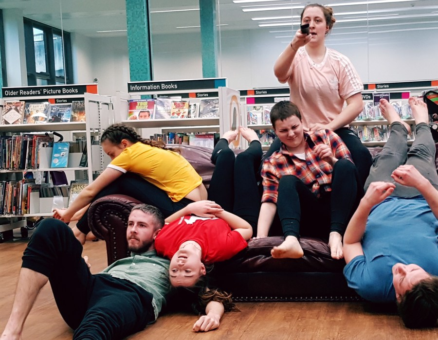 'Six on a sofa' at Exeter Children's Library.  A live performance, written and performed by a group Exeter University Drama students. Exploring Exeter 2018, pics by Liz Finnie