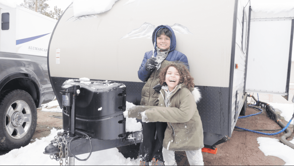 Fulltime RVing kids enjoying the snow.