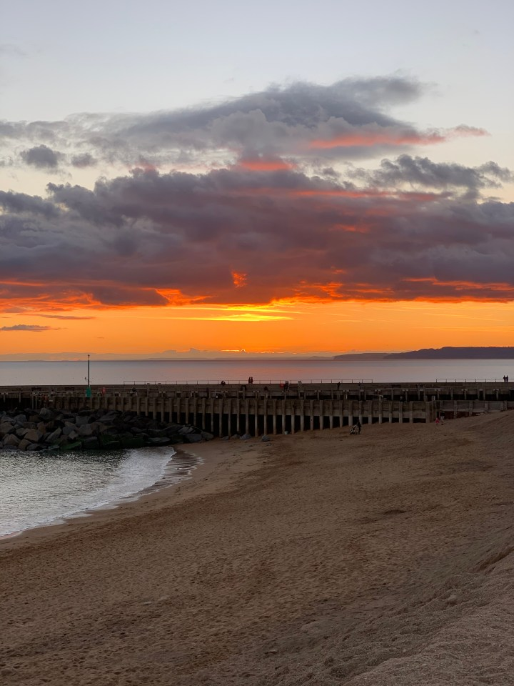Orange-red tones at sunset in West Bay