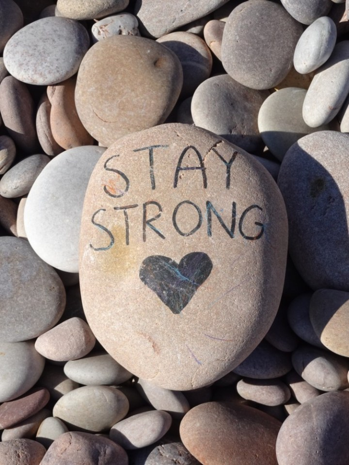 'Stay Strong' - pebble art on Budleigh Beach