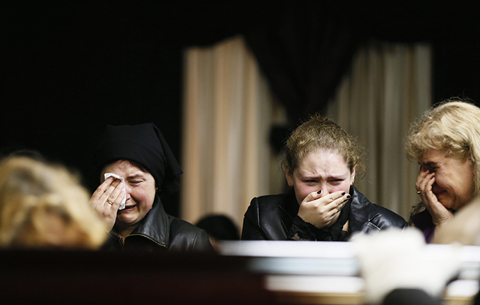 Mourners grieve at coffin of Markin, regional parliament deputy who died in fire at trade union building on Friday, at his funeral in Odessa