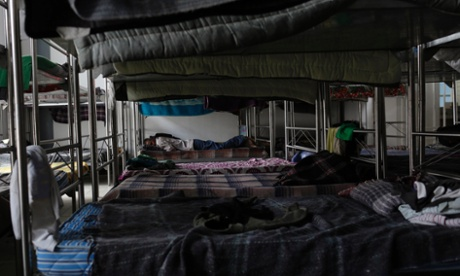 A migrant sleeps on a bunk bed inside a Catholic migrant shelter in San Luis Potosi. Photograph: Carlos Jasso/Reuters
