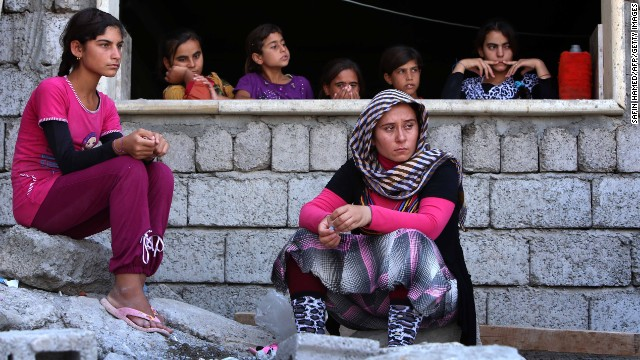 Yazidi women who fled violence in Sinjar, Iraq, take shelter at a school in Dohuk, Iraq, on August 5.