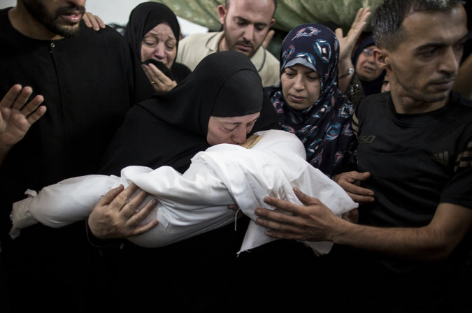 The grandmother of 8-month-old Ali Dief, a son of Hamas's military chief, mourning at the child's funeral. Wissam Nassar for The New York Times