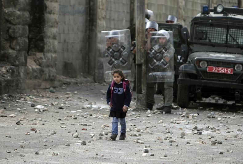 37_Palestinian Girl Walking Towards her School Unconcerned Israeli Forces