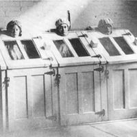 Patients in steam cabinets in the early 1900