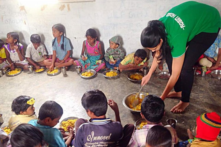 Robin Hood Army giving food to children