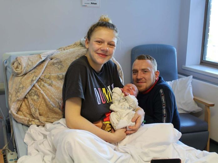 Katie Lymn and Daniel Paddock, with their new born son Freddie. The photo was taken socially-distanced by a masked member of staff.