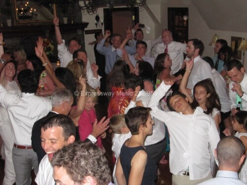 Wedding guests dancing at Milbrook CC in Greenwich CT