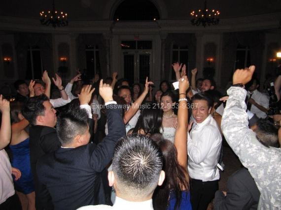 Dancing at NJ Wedding with hands in air