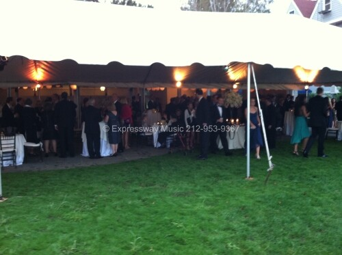 Guests enjoy Cocktail hour under tent at Larchmont Yacht Club Wedding