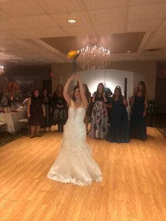 bride about to throw bouquet to dj song at Perona Farms wedding in new Jersey