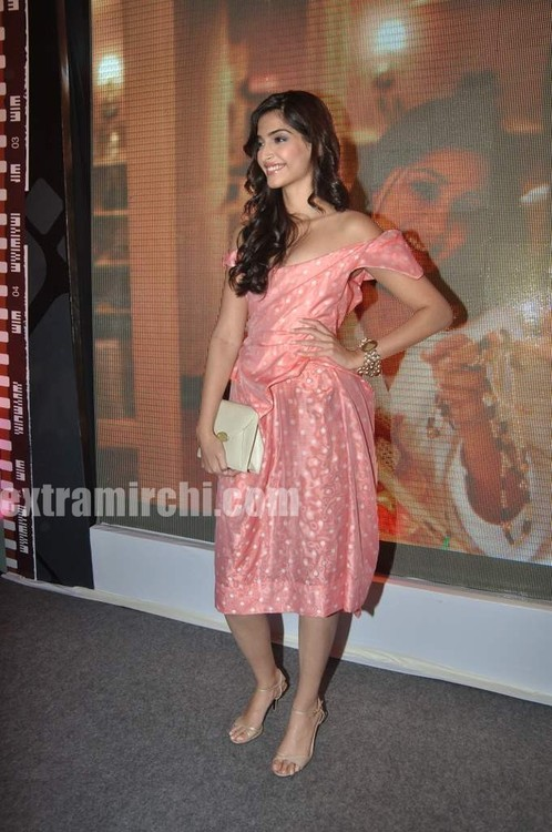 Sonam-Kapoor-with-Coral-voile-polka-dot-fitted-dress-from-Vivienne-Westwood-4.jpg