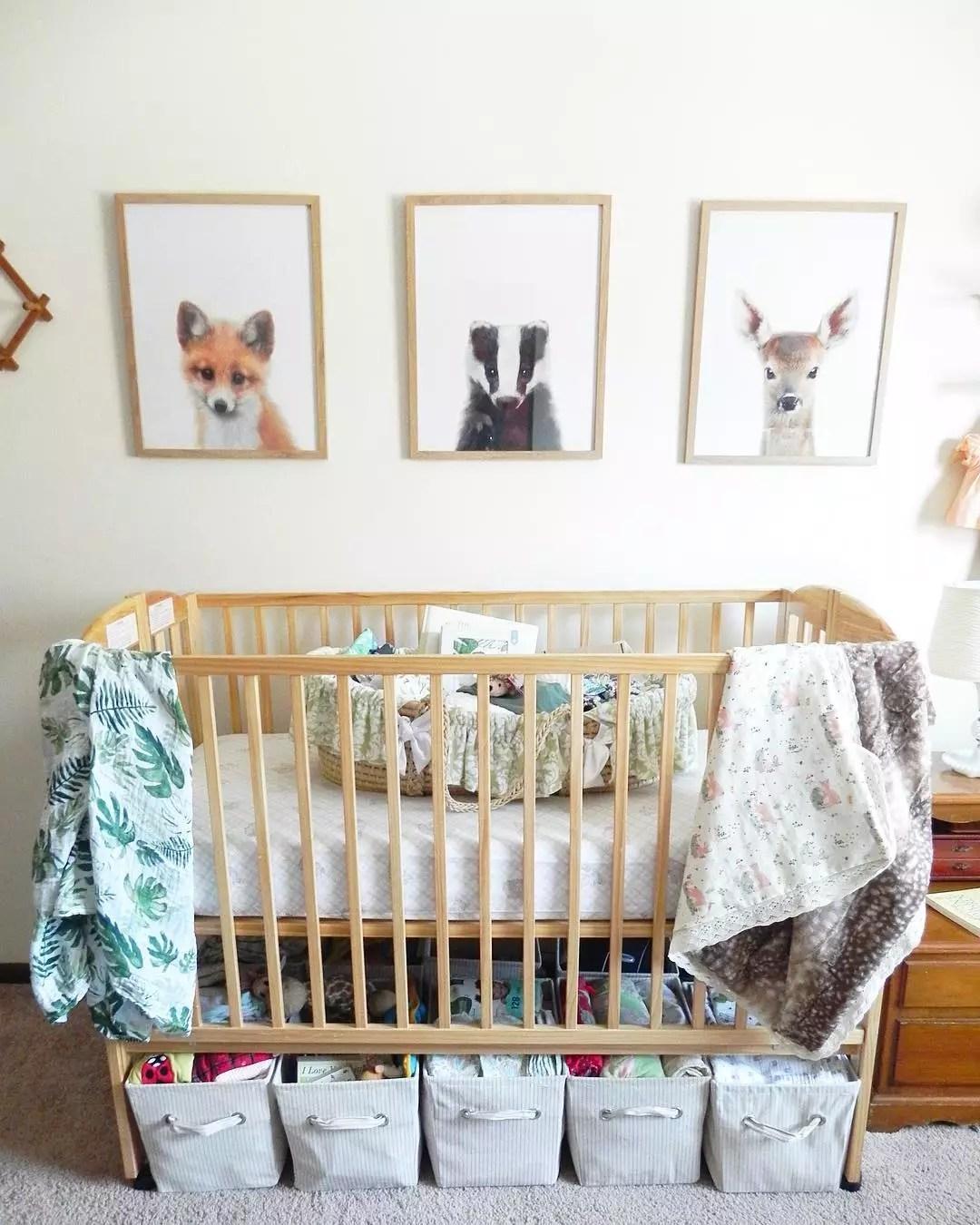 Storage bins under baby crib in small home. Photo by Instagram user @4_little_1