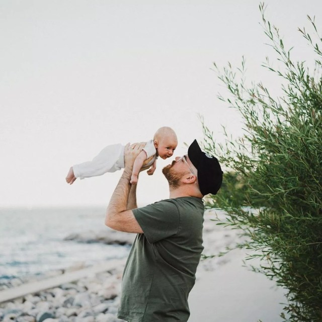 Dad holding infant. Photo by Instagram user @jeremy_tozer