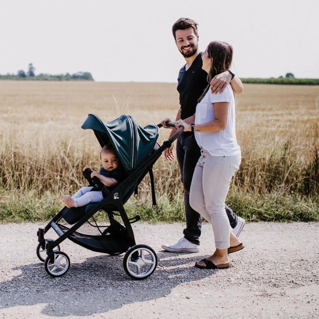 Photo of couple walking with baby in stroller. Photo by Instagram user @kocarky_duha